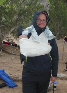 Injuries in every settings... here I'm sporting a mid-humeral splint fashioned out of a camping chair (in the rain and on the river).