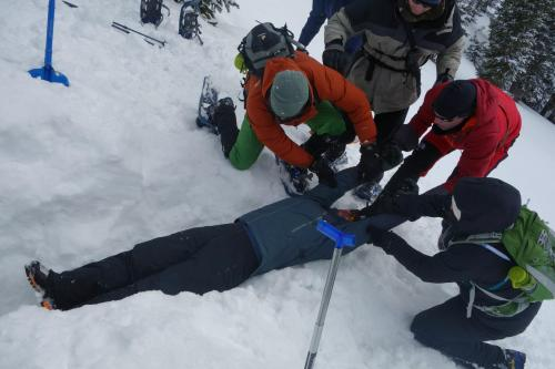 "It's not what you would do in a hospital setting, but how do you get someone with a potential cervical-spine injury free after you've just dug them out of an avalanche slide? Stabilize their neck with their arms and drag them! (And kudos to our instructors.  Not only did they dig a deep snow cave for us to locate with avalanche beacons, but one of the brave residents agreed to be buried down there for one of our ""scenarios"". I wish I could have seen the look on my face when we realized there was a person 5 feet under the snow!)"