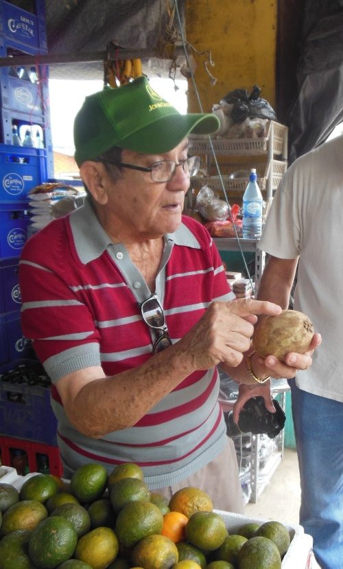 One of our stops on our photo tour of the twin cities was the market place, where Don Hector identified a number of new fruits for me.  Here he is singing the praises of the Sapodilla- the fruit from the tree that produces chicle (the traditional starting ingredient for gum). Belize used to export large amounts of chicle when it was still used in chewing gum. Don Hector likes to joke that Belize is actually a part-owner of Wrigley Field in Chicago.