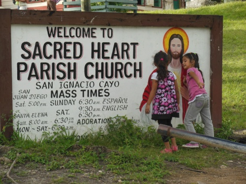 "More ""free-range"" kids.  These girls kept running up to this painting of Jesus and giving him hugs.  There have been a lot of missionaries in Belize over the years.  Pentecostals, Nazarenes, and Mormons have all tried to make inroads into this culture.  I went through customs behind a group of young Mormon missionaries."