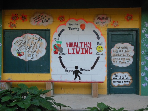 There's definitely a push to teach kids about healthy living.  I thought this mural on a school wall was much better than the USDA food pyramid, but maybe that's just me… Unfortunately, I saw kids eating a lot of junk food in Belize- candy, chips, and Coca-cola are ubiquitous in Belize (note- there is no Pepsi in Belize- they were run out years ago. Bowen and Bowen [http://en.wikipedia.org/wiki/Barry_Bowen] dominate the beverage industry in Belize).