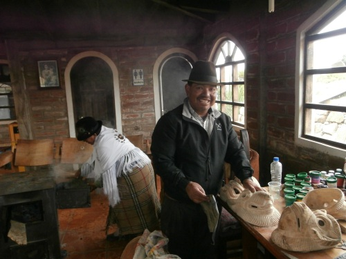 In addition to running a hostel, the owner of this establishment makes and sells wooden masks.  In the back you can see him wife tending to the wood-burning stove.